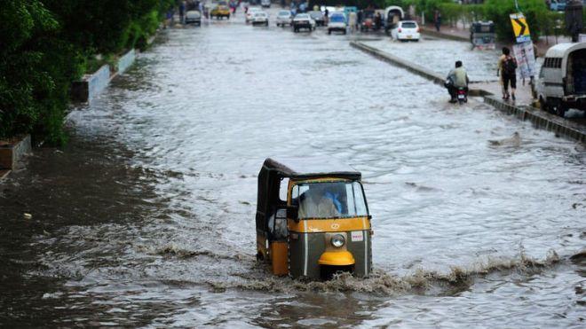 Auto Rickshaw in Flood Water