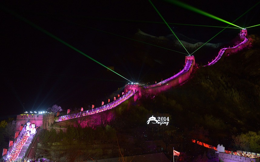 A lightshow illuminates the Great Wall