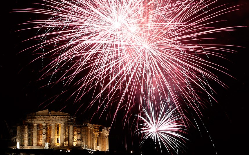 Fireworks explode over the ancient Parthenon temple at the Acropolis Hill