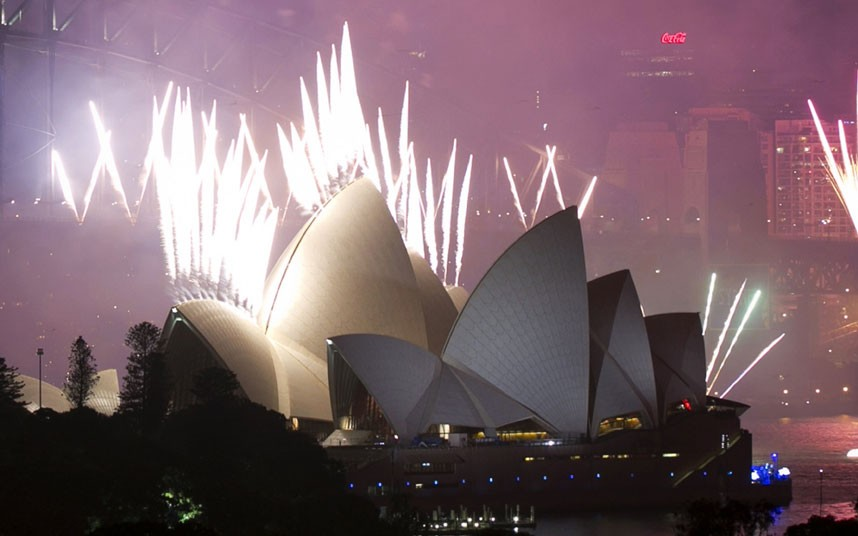 Fireworks explode off the Sydney Opera House at midnight, ushering in the new year