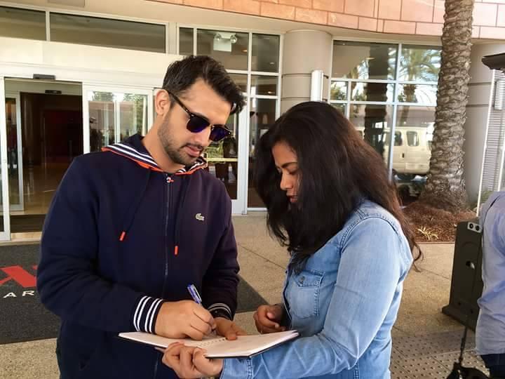 Atif Aslam Signing An Autograph On His US 2015 Tour