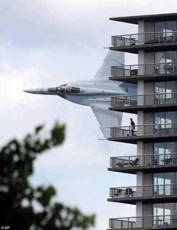 Crazy fighter jet flyby an apartment building