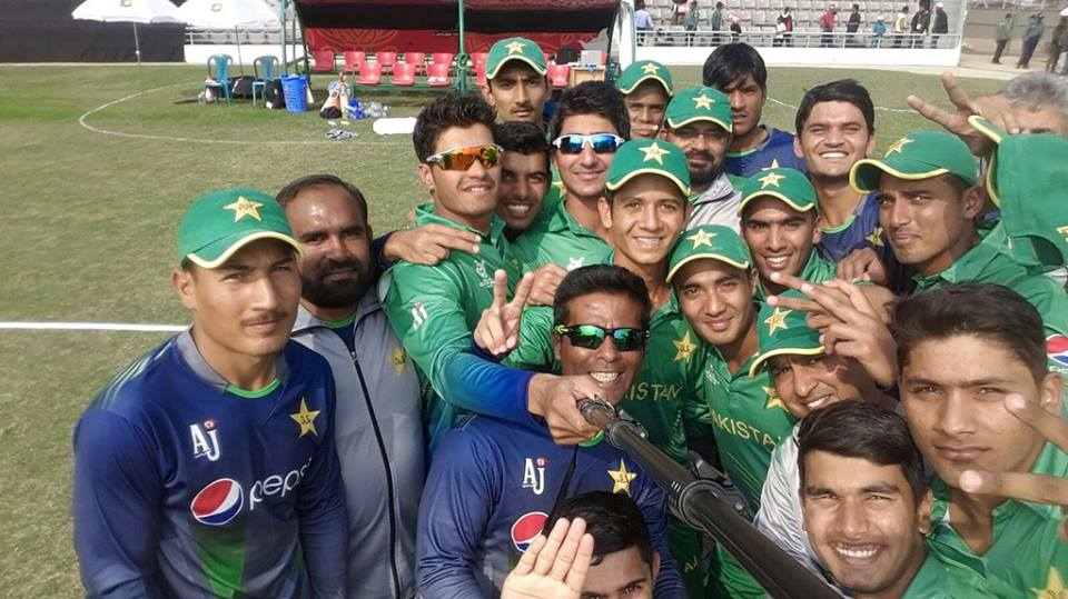 A smiling Pakistan U-19 team winning selfie