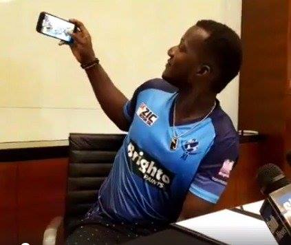 Darren Sammy Clicking A Selfie In World XI Jersey