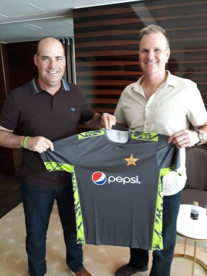 Head Coach Presenting The Pakistan Team Training Kit To Fielding Coach Grant Bradburn