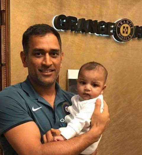 MS Dhoni Holding Sarfraz Ahmed's Son