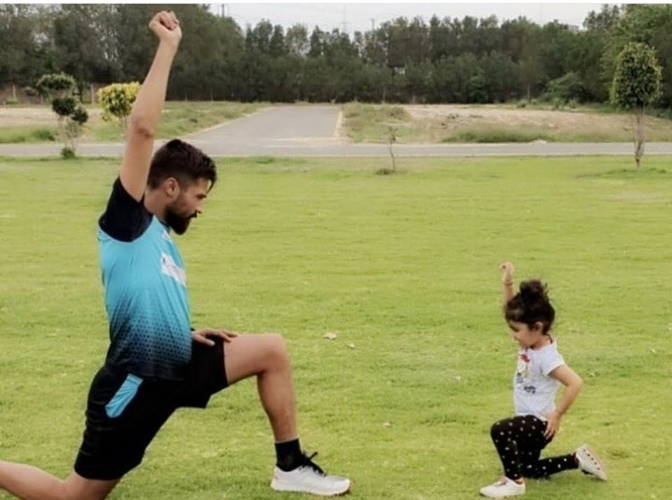 Muhammad Amir Doing Exercise With His Daughter