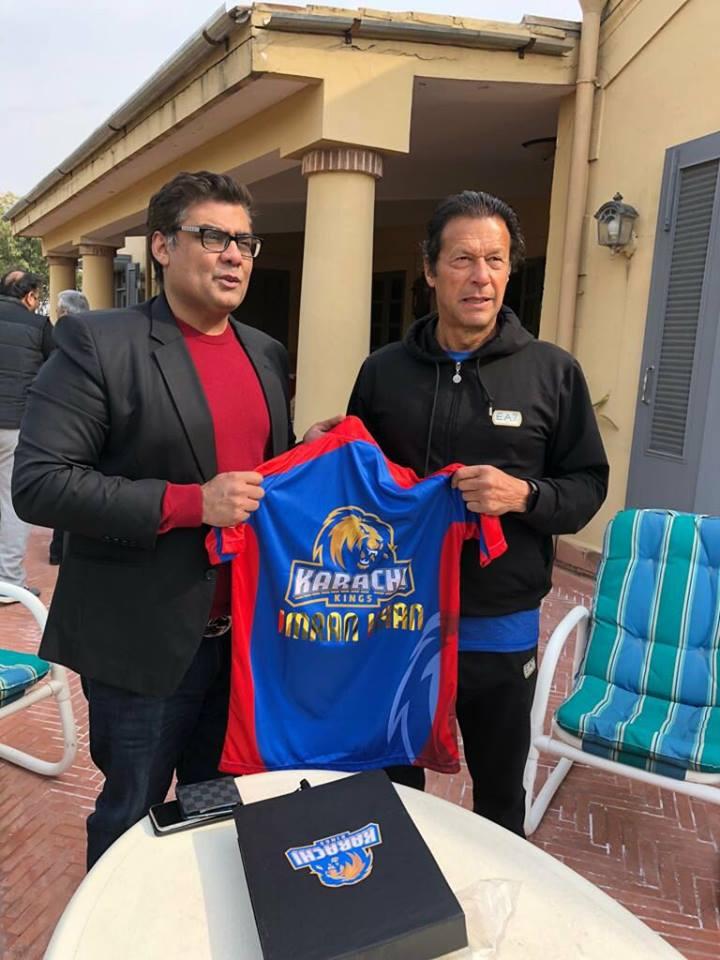 Salman Iqbal Presenting Karachi Team PSL 3 Jersey To Imran Khan