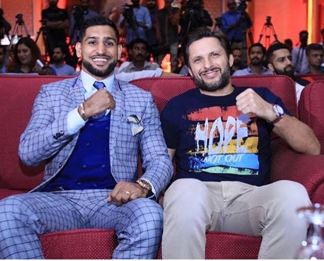 Shahid Afridi Poses With Amir Khan At The Opening Of His Boxing Academy