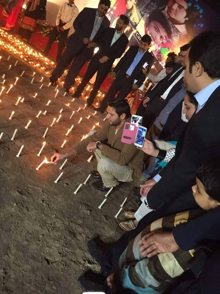 Shahid Afridi‬ & team lighting candles at the vigil