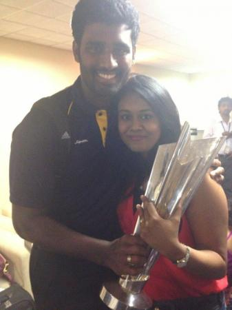 Thisara Perera With His Wife Sherami And WT20 2014 Trophy