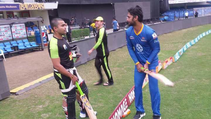 Umar Akmal Receiving Batting Tips From Kumar Sangakkara