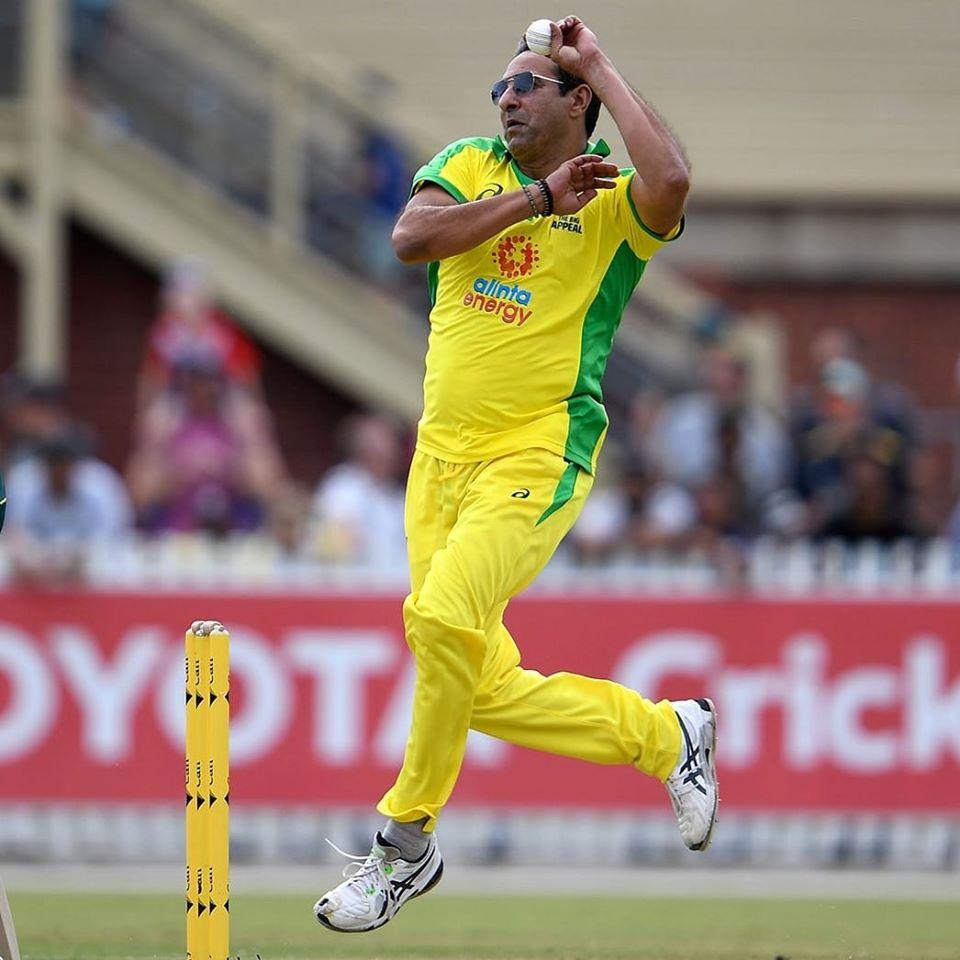 Wasim Akram In Action During Bushfire Cricket Match At Australia