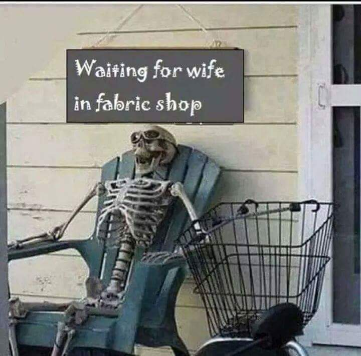 Waiting For Wife In Fabric Shop