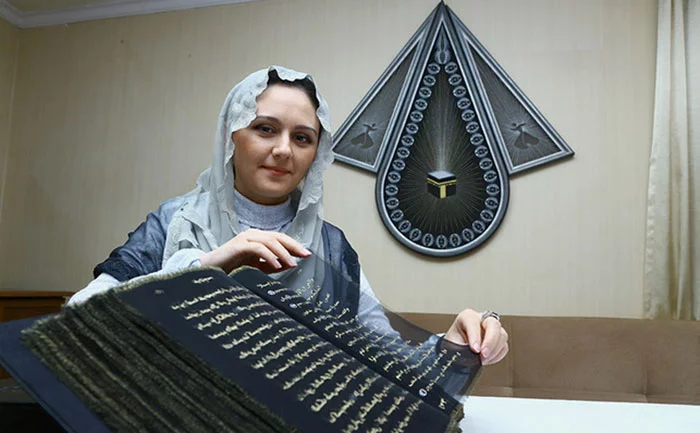 Artist From Azerbaijan Spends Three Years Writing Quran With Gold On Silk