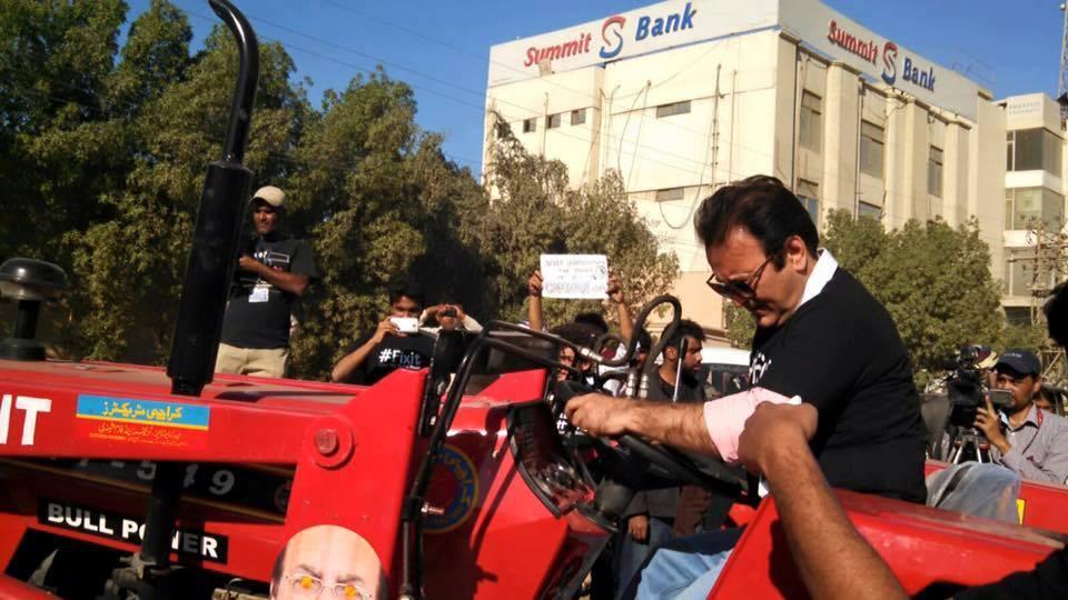 Behroz Sabzwari driving fixit tractor