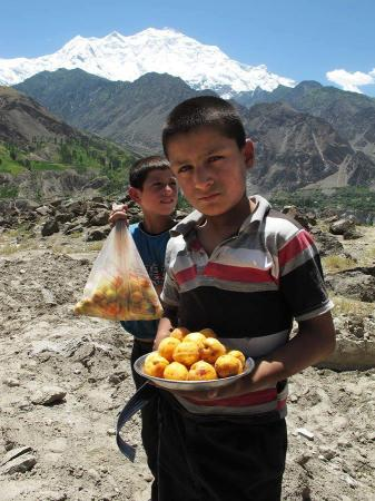 Local boys Selling Apricots in Hunza valley, Pakistan