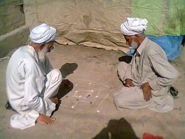 Old people playing game in a Village of Pakistan