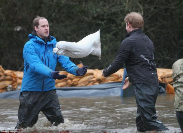 Prince William and Prince Harry Helping In Flood