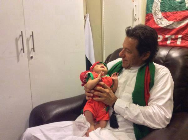 Imran Khan With One Of The Youngest PTI Supporter