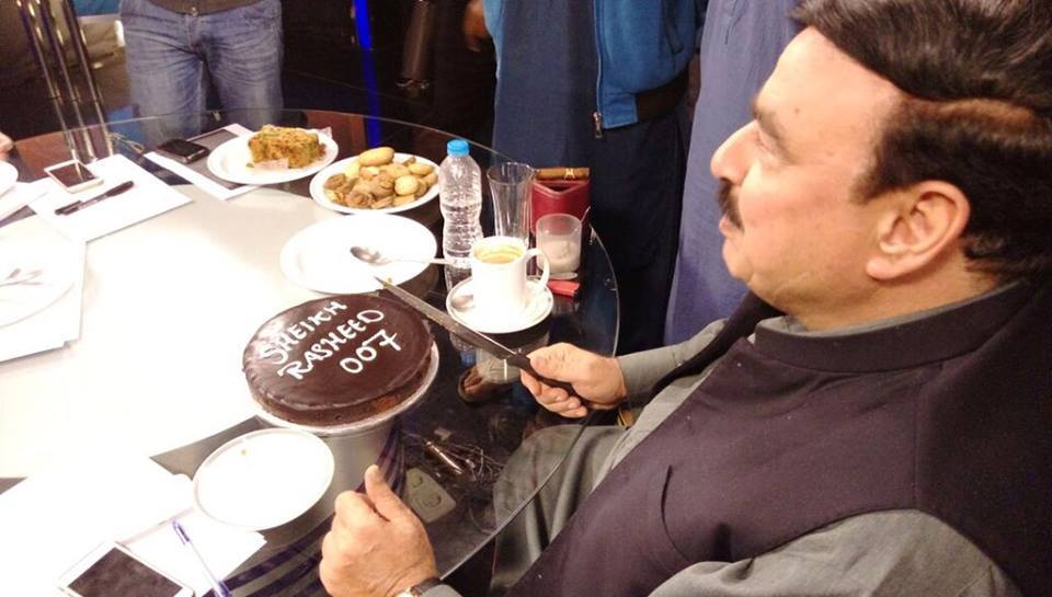 Sheikh Rashid Cutting His Birthday Cake As 007