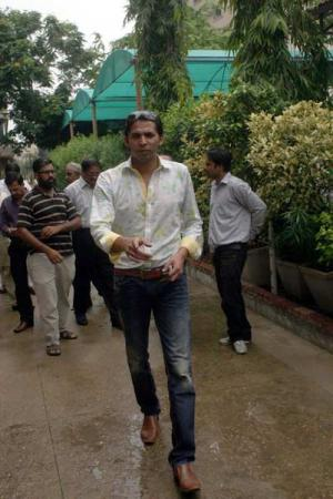 Pakistani cricketer Mohammad Asif arrives for a press conference